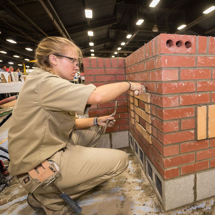 female masonry working on a masonry project