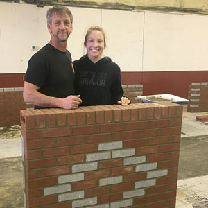 female masonry and her coach with her project
